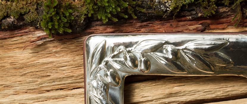 Dettaglio cornice argento galletto